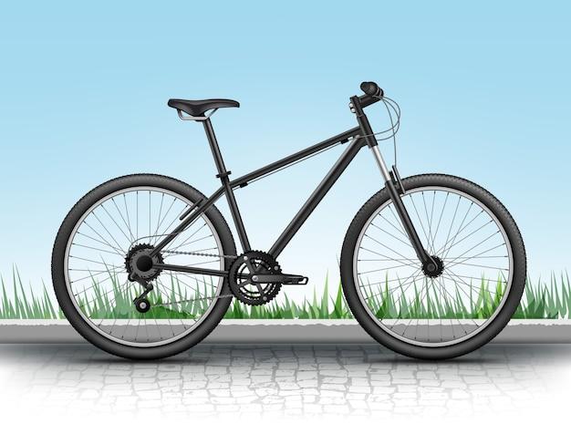 Realistisches mountainbike lokalisiert auf steigungshintergrund mit gras und kopfsteinpflaster
