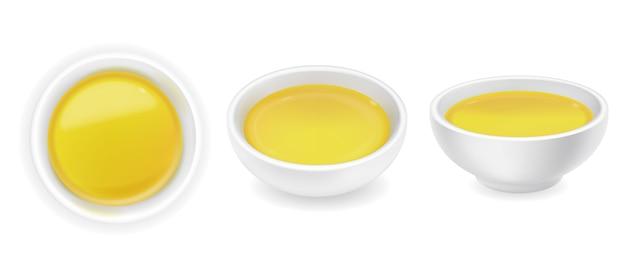 Realistisches oliven- oder sonnenblumenöl in einem runden saucenschüsselset. gelber flüssiger honig lokalisiert auf weißem hintergrund. lebensmittelillustration
