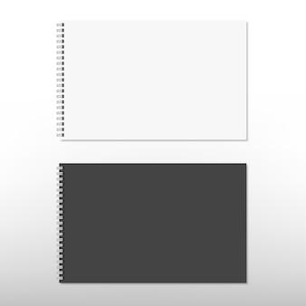 Realistisches weißes und schwarzes spiralblock-notizbuch lokalisiert auf weiß. .