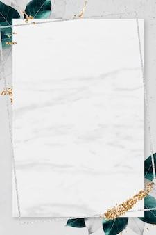 Rechteckiger silberner rahmen mit laub auf marmorbeschaffenheitshintergrundvektor