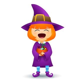 Redheadmädchen im kostüm der hexe