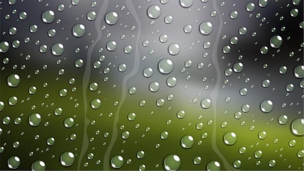 Regen-tropfen auf windschutzscheibenautofenster mit unscharfer natur