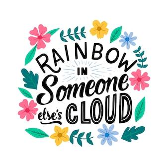 Regenbogen in einer fremden wolkenschrift mit blumen