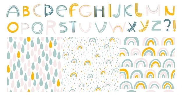 Regenbogen und tropfen. alphabet und nahtlose muster. skandinavische kinderhand gezeichnete illustration in den pastellfarben. isoliertes set zum drucken auf t-shirts, textilien, karten