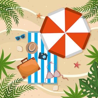 Regenschirm mit handtuch und aktentasche mit hut im handtuch