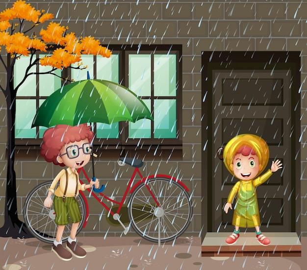 Regnerische jahreszeit mit zwei jungen im regen