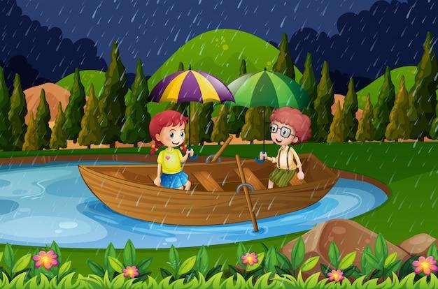Regnerischer tag mit zwei kindern im ruderboot