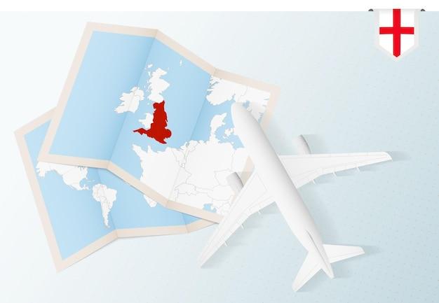 Reise nach england draufsichtflugzeug mit karte und flagge von england