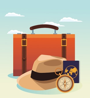 Reisekoffer und hut mit kompass und reisepass