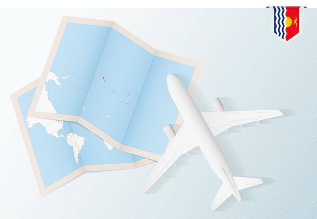 Reisen sie nach kiribati, draufsichtflugzeug mit karte und flagge von kiribati.