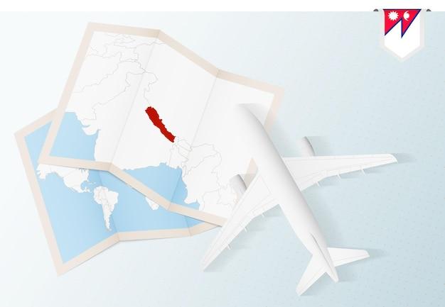 Reisen sie nach nepal, draufsichtflugzeug mit karte und flagge von nepal.
