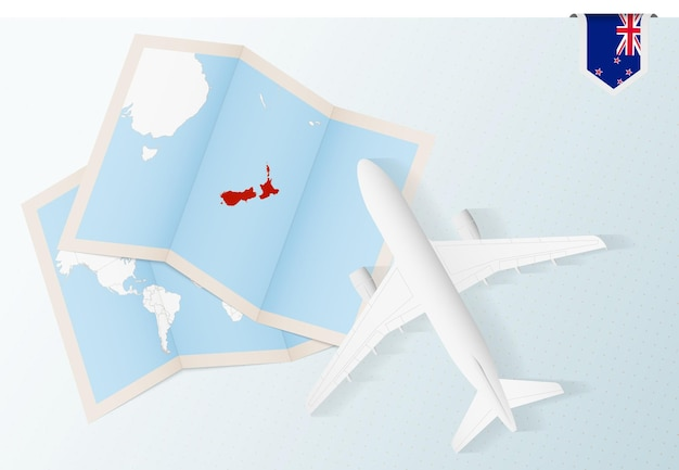Reisen sie nach neuseeland, draufsichtflugzeug mit karte und flagge von neuseeland.