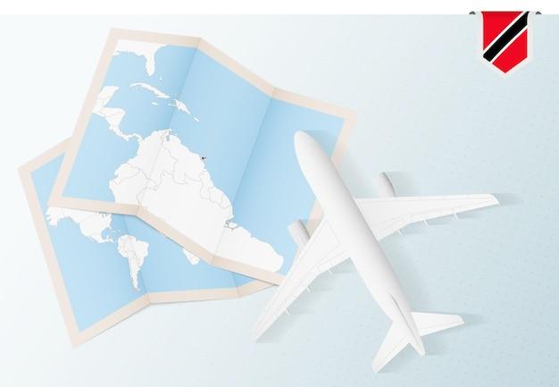 Reisen sie nach trinidad und tobago, draufsichtflugzeug mit karte und flagge von trinidad und tobago.