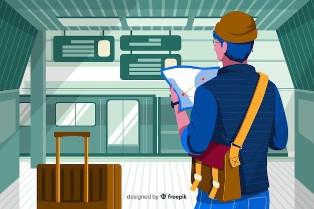 Reisender junge, der eine karte betrachtet