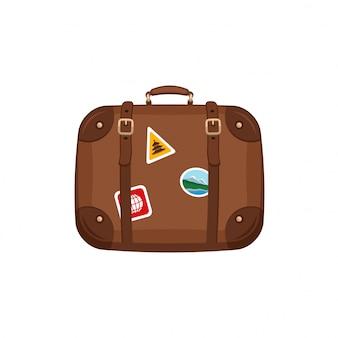 Reisetaschenkoffer mit aufklebern auf isoliertem weiß