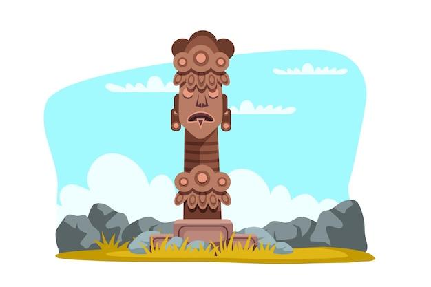 Religiöses symbol des hölzernen stammestotemgottes unter steinen