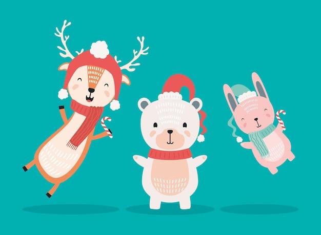 Rentier mit eisbär und kaninchen, die weihnachtskleidungsfiguren tragen
