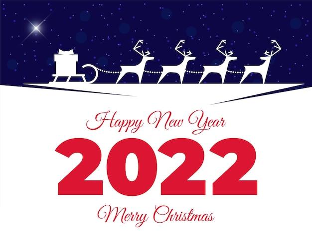 Rentiergeschirr mit geschenkbox auf schlitten frohe weihnachten und ein glückliches neues jahr 2022 grußkarte