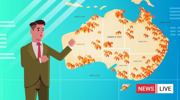 Reporterjournalist der letzten nachrichten live-brodcasting-karte von australien mit symbolen von buschfeuersaison-waldbränden, die das konzeptporträt der globalen erwärmung der naturkatastrophe flach brennen