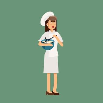Restaurantkochfrau, die eine schüssel hält.