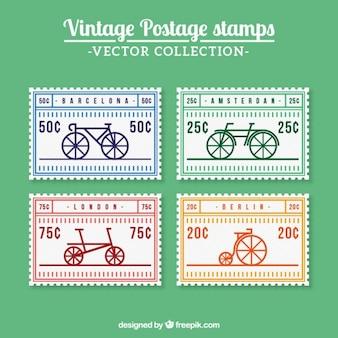 Retro briefmarken mit fahrrädern in flaches design