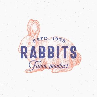 Retro druckeffekt abstrakte zeichen-, symbol- oder logo-vorlage. hand gezeichnete kaninchen-sillhouette-skizze mit typografie. vintage farm produkte emblem oder stempel.