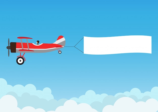 Retro flugzeugfliegen mit werbungsfahne auf blauem himmel