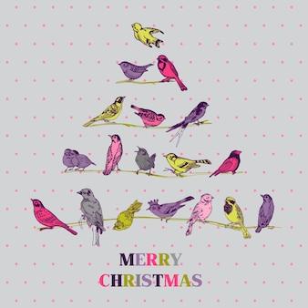 Retro weihnachtskarte vögel auf weihnachtsbaum