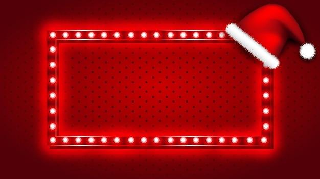 Retro weihnachtslichtzeichen mit weihnachtsmannhut auf rotem hintergrund