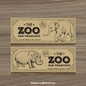 Retro zoo-tickets mit der hand gezeichnet elefanten und hippotamus