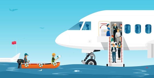 Retter retten fluggäste vor überfluteten landebahnen