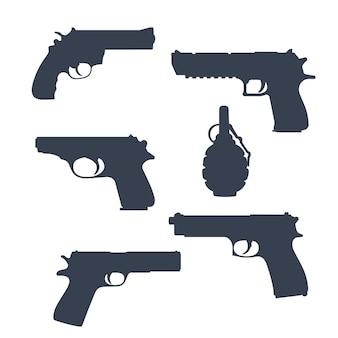 Revolver, pistolen, pistole, handfeuerwaffen, granatensilhouetten isoliert auf weiß