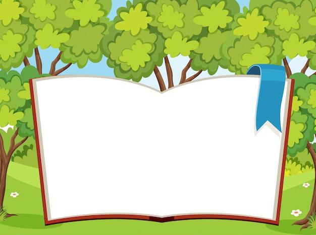 Riesenbuch mit leeren seiten mit wald im hintergrund