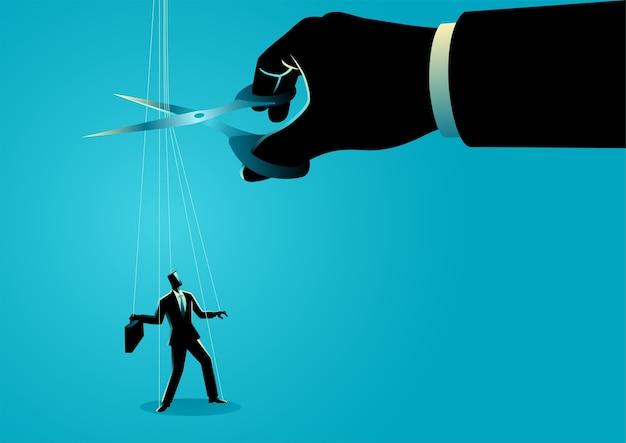 Riesige hand mit einer schere, die die fäden schneidet, die am geschäftsmann befestigt sind. freiheit, unabhängigkeit, befreiung, kontrollkonzept