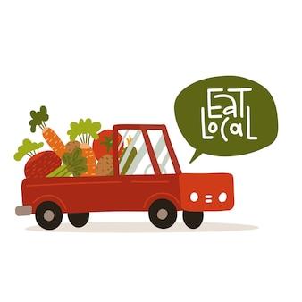 Riesiges gemüse im lkw lokalisiert auf weißem hintergrund. natürliche organische frische lebensmittel. landwirtschaft oder landwirtschaftskonzept. schriftzug zitat - essen sie lokal. flache vektorillustration.