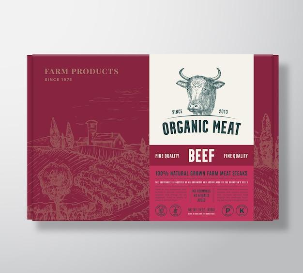 Rindfleisch in premiumqualität verspottet bio-vektor-fleischverpackungsetikettendesign auf einem kartonbehälter ...