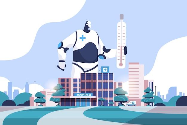 Roboter hält thermometer an einer krankenhausfassade