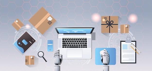 Roboterhände mit laptop online-shopping expressversand lieferung bot service-konzept