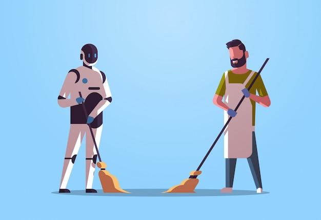 Roboterhausmeister mit dem mannreiniger, der roboter gegen das menschliche stehende zusammen technologiekonzept der künstlichen intelligenz flach in voller länge horizontal fegt und säubert