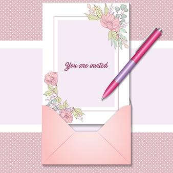 Romantische einladungskarte mit realistischem stift und umschlag