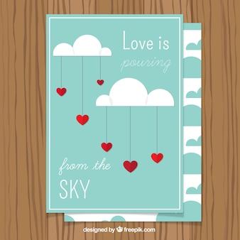 Romantische karte mit wolken und herzen hängen