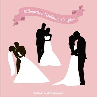Romantische silhouetten der hochzeitspaare