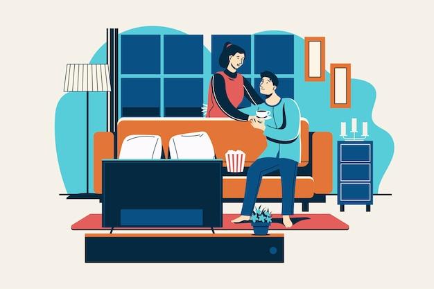 Romantisches paar, das heißes getränk im wohnzimmer trinkt