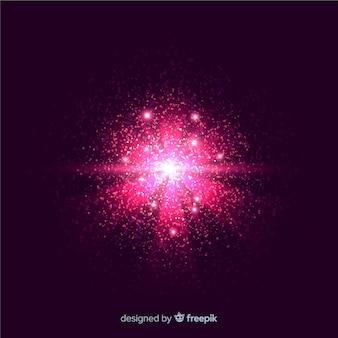 Rosa explosionspartikeleffekt auf schwarzen hintergrund