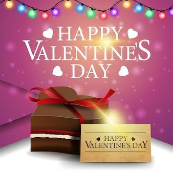 Rosa grußkarte zum valentinstag mit praline