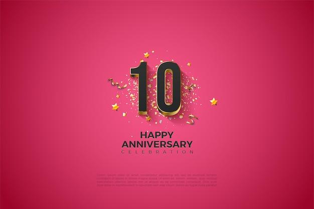 Rosa hintergrund für 10-jähriges jubiläum mit schwarzen zahlen in vergoldet
