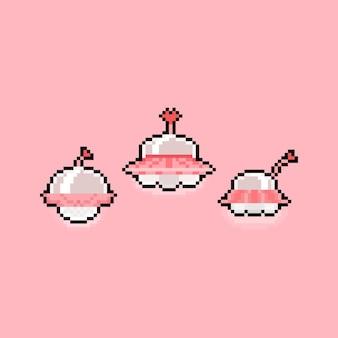 Rosa ufo-symbolsatz der pixelkunstkarikatur.