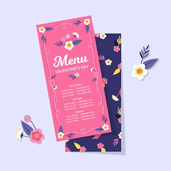 Rosa und blaues restaurantvalentinsgrußmit blumenmenü