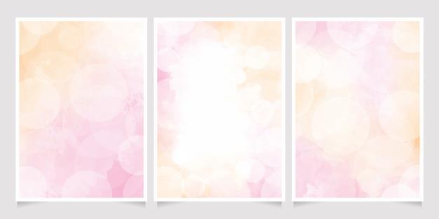 Rosa und goldaquarellwaschspritzer mit unscharfem bokeh 5x7 einladungskartenhintergrundschablonensammlung