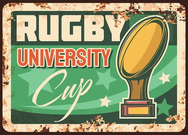 Rostige metallplatte des rugby-pokals der universitätsliga. goldene tasse mit quanco ball auf ständer, sterne und typografie